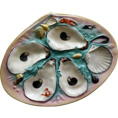 UPW , for Union Parcelain Works, oyster plates have been favored for years by collectors because of their individualistic designs with their