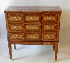 A Louis XVI period Est of France marqueterie chest of drawers
