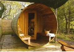 Large barrel converted into an outdoor sauna.