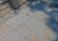 I am sure that are various companies that make this type of paver, but I happen to love this one. It is made by Techo-Bloc. It comes in a few different colors and patterns, but the ones shown above are called Aberdeen. The color is Azzurro which looks