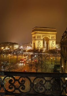 Night view of the Arc de Triomphe from the Hotel Splendid Etoile, Paris.