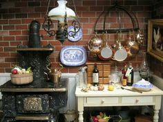 Vintage kitchen. Wood stove. Pot rack. Brick wall. So cute. Oil lantern. Dollhouse miniatures. Blue & white dishes.
