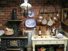 Vintage kitchen. Wood stove. Pot rack. Brick wall. So cute. Oil lantern. Dollhouse miniatures. Blue & white dishes.