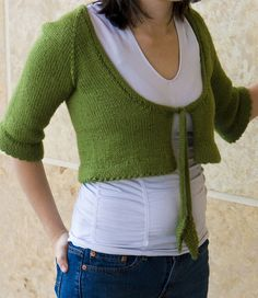 Free Knitting Pattern for Bolero with Leaf Ties - Cropped cardigan with elbow length sleeves, scoop neck, and picot edge. Sizes 32 (34 ½, 37 ½, 40, 4 2½, 45). Worsted weight. Designed by Stefanie Japel for Knitty. Pictured project by Shalena