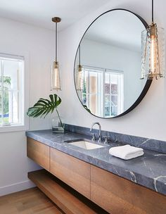 We're smitten with the long counter and curb backsplash in this fresh bathroom by Texas-based designer Martha O'Hara.