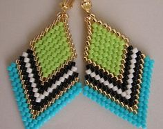 These earrings are my own original design. Copyright - Patti McAlister 2014 These pretty beadwoven earrings are handmade with dark matte turquoise, matte purple, cream, black, & golden delica seed beads. They measure 2-1/4 long which includes the plated leverback earwires, & 1-1/8 wide.