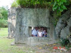 A WWII bunker on the beach in Guam; Bryan, Alex, Erica, Cole--2003