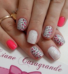 A pretty pink and white leopard nail art design with glitter.