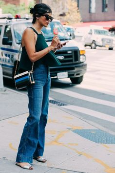 """Need! High-waist flares that can be worn with flats. (Except maybe this woman is 6'3"""")"""