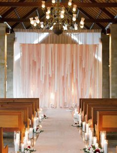 Light pink church backdrop, candle aisle decorations