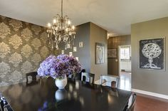 Gorgeous Damask pattern statement wall and dark painted walls.