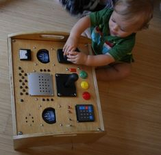 Kids tactile play box / control panel. Pretty neat!  Harrison plays with his box