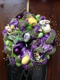 Bright purple Easter Wreath...I love this and normally I don't really Easter decorate!  It has made me reconsider...