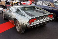 The Maserati Merak is a mid-engined 2+2 sports car produced by Maserati between 1972 and 1983.[1] The Merak was closely related to the Maserati Bora, sharing part of its structure and body panels, but was powered by a 3.0 L V6 in place of the latter's 4.7 L V8. The extra cabin space gained by fitting a smaller and compact powertrain was used to carve out a second row of seats - suitable for children or very small adults - making the Merak not just a less expensive alternative to the Bora ...