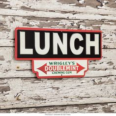 This reproduction Wrigley's Gum sign brings vintage style to your home or business decor. It's made of embossed, die-cut tin with details that really stand out. A great fit for any kitchen, game room or business! Measures 13W x 5.9H inches.