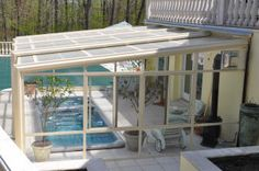 Roll-A-Cover's Retractable Sunroom Enclosure over a swim spa. Now they can use their swim spa year-round!