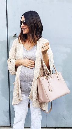 A long cardigan, a grey tee, and white jeans