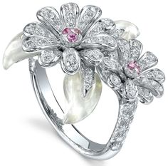 Asprey Crown Daisy Ring, Diamonds & Pink Sapphires. Crown Daisy Ring with pavé diamonds and pink sapphires, set in 18ct white gold.