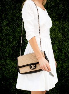 classic Chanel nude and black handbag