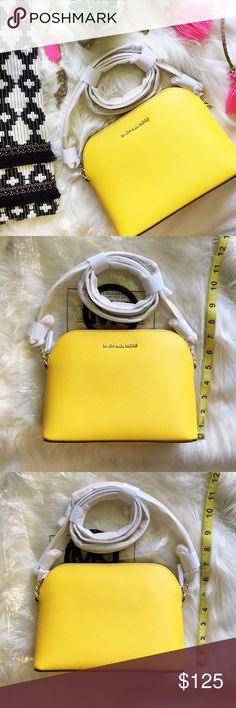 Michael Kors Large Cindy Dome Crossbody Lavish Saffiano leather textures a lightly structured crossbody bag edged in polished chain links for a sophisticated, street-savvy look. Color is sunflower with gold hardware. Top zip closure. Adjustable crossbody strap. Interior zip and wall pockets. Logo-jacquard lining. Leather. By MICHAEL Michael Kors; imported. MICHAEL Michael Kors Bags Crossbody Bags