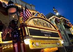 The Main Street Cinema marquee, lit up and adorned with American flags, photographed on Main Street, U. at Disneyland Park in Anaheim, Calif. Disneyland Tips, Disneyland Resort, Disney Anaheim, Steamboat Willie, Steamboats, Pirates Of The Caribbean, Main Street, Attraction, Cruise