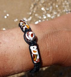 Baltic Amber pieces set in a white clay. Adjustable cotton bracelet.