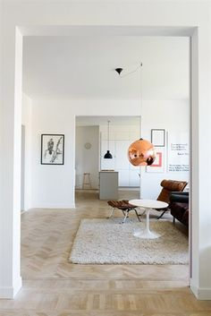 tom dixon copper shade pendant living area by Emma Persson Lagerberg