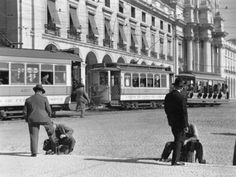Bootblacks at Work in Front of the Ministry of Marine on the Praca Do Comercio in 1936 Photographic Print by W. Robert Moore at AllPosters.com