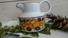 Check out this item in my Etsy shop https://www.etsy.com/listing/109898227/retro-stoneware-pitcher-made-in-england