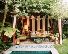 Cabana Glamour - Outdoor Patio Design Ideas - Who doesn't love a gorgeous garden tent? This one is particularly appealing, with striped fabric and soft lighting to set a seductive mood. Smooth pebbles serve as a seamless transition from patio to pool. Outdoor Rooms, Outdoor Gardens, Outdoor Living, Outdoor Seating, Outdoor Lounge, Outdoor Furniture, Poolside Furniture, Backyard Seating, Outdoor Patios