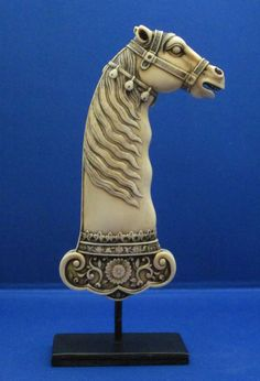 A very rare and extremely finely carved Mughal (Mogul) ivory dagger handle, dating to the late century. This example depicts a royal horse with an extravagant maine and beaming, large eyes. Horse Head, Horse Art, Indian Sword, Mughal Empire, Swords And Daggers, Horse Sculpture, Equine Art, Polymer Clay Art, Equestrian Style
