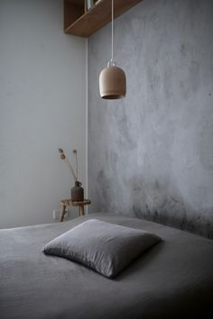 The Poiju lamp fits beutifully in this bedroom.