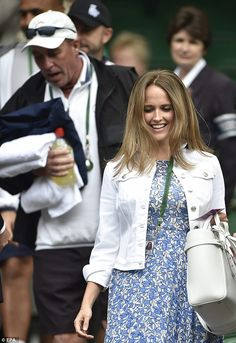 In spite of the grey day Kim Murray, 29, she was perfectly summery in a £325 silk dress fr...