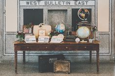 travel inspired guest book table http://greenweddingshoes.com/eclectic-snowy-montana-wedding-kellene-cole/