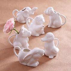 Milk jugs/bud vases. Puppy, bunny, duck, cow, cat, or elephant.