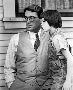 Atticus Finch and his daughter Scout Finch. To Kill A Mocking Bird. Probley my favorite book of all time. The movie is great too,