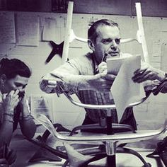 Engrossed in #design. #mcm #geniuses #charlesandrayeames #workinghard on an #eameschair. #midcentury #designers #industrialdesign #interiordesign #moderndesign #1950s #1960s #graphicdesign #art #artists #midcenturydesign #midcenturyfurniture #charleseames stuck in a chair #rayeames #designinspiration #eames #hermanmiller #husbandandwife #coolness