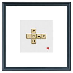 Cross Stitch Scrabble LOVE YOU image, in your choice of black or white frame. Unique gift idea and great for both men and women. Unique gift for Valentines Day, Birthdays, Mothers Day, Fathers Day, Anniversaries, Baby & Wedding Showers. Centre area is 5 x 5, and with mat, the