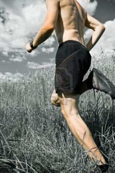 Man running cross country on trail, sport and fitness outdoors Stock Photo