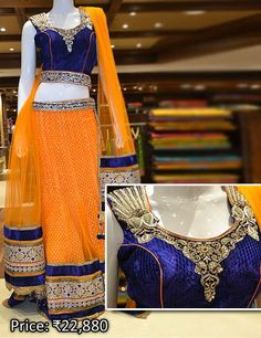 Orange net lehenga and royal blue choli with sequins work and embroidered bold attractive appliques and similar hemline.