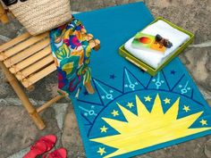 Paint a Patio Pool    Create your own relaxation zone with a hand-painted rug inspired by a mosaic swimming pool. A plain bamboo mat takes on the color of azure waters with just a can of exterior spray paint, painted acrylic desi… more