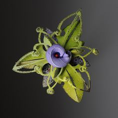 Looking at Linda Threadgill's fanciful metal, multi-layered brooch's from her Rosette series gave me a much needed burst of color and hope – they are so vibrant and bold!  Beautiful layering of texture, pattern, color and shape.