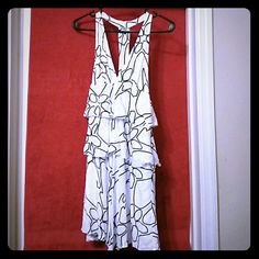 **75% OFF SALE!!!**Sexy razor back Armani dress! ***75% OFF!!!*** Only worn once. From a smoke free home.  No defects. Looks brand new. Armani Exchange black and white giraffe print. Armani Exchange Dresses Mini