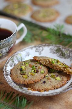 Pistachio Cardamom Shortbread   1 cup unsalted butter, softened to room temperature 1 1/4 cup whole spelt (or whole wheat) flour 1/2 cup confectioner's sugar 1/2 cup ground pistachios 1 tsp. ground cardamom 1/4 cup finely chopped pistachios for garnish