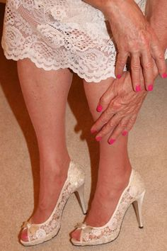 Crossdresser painted pink nail varnish and matching toes