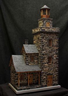 lighthouse made of fieldstone and black granite weight about 120 pounds and 3 feet hight