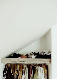 Like the wooden shelf, cool idea for a small space.