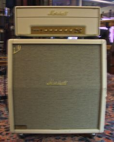 Marshall Stack!  Shocking white covered 1960AX 4x12 cabinet with a50 watt MK II head. This thing's got power to spare and tone out the wazoo. Plenty of warm tone and spank from the four Celestion G12T75 greenbacks. Great looking and sounding stack with the 60's - 70's vibe.