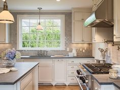 "Old Farmhouse charm...""khaki' glass subway tile. Love the grey counters with white cabinets"