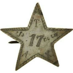 Civil War Period Silvered Hat Badge of the 17th Texas Infantry. Having its origins in the period when Texas was an independent republic, this emblem was also used by Civil War Texas soldiers and has been observed on equipment, most notably wooden canteens, as well as buttons and various forms of insignia. This example is indigenous to Texas having been acquired from a noted Houston collector in whose hands it had resided for some 40 years.